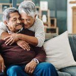 Older adult Latina couple hugging